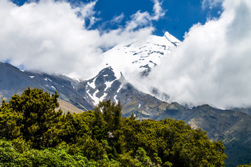 A view of a snow covered Mount Taranaki in the clouds, Edgemont National Park, New Zealand