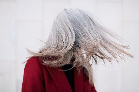 Senior woman tossing hair