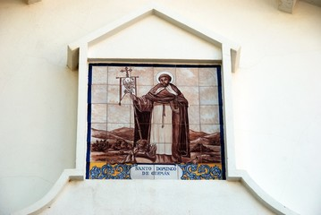 Ceramic saint picture on the wall of the Santo Domingo de Guzman church, Benalmadena Pueblo, Spain.