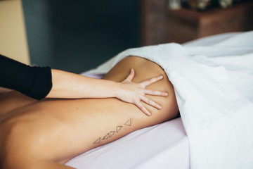 Woman treatment at spa center.