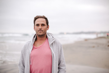 Portrait of serious man at the beach