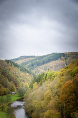 Maboge beach in beautiful autumn scenery and colors with the Ourthe river Ardennes