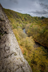 Steep le Herou cliff eroded by the Ourthe river Belgium Ardennes