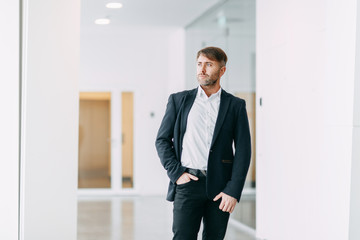 Businessman goes to work. Bright interior and office.