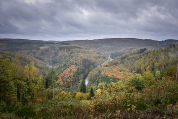 Moody and dark panorama of an Ardennes valley with Ourthe shaping the landscape