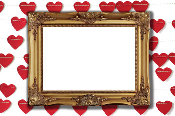golden picture frame with red paper heart background