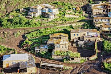 Fragment of village on hillside