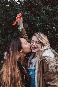Two female friends out on a winter walk