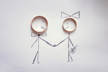 Drawing the bride and groom with wedding rings