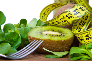fruits and vegetables with tape measure, concept of diet and health