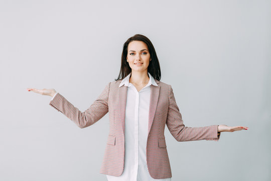 Beautiful girl weighing decisions, the choice of options. Business coach at performance.