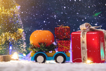 Toy car carries gifts in the new year. The concept of the Christmas mood