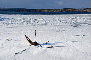 Snow-covered ice on lake Uvildy in late autumn. South Ural, Chelyabinsk region, Russia