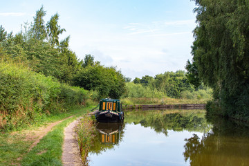 Narrow boat on the Trent and Mersey canal in Cheshire UK