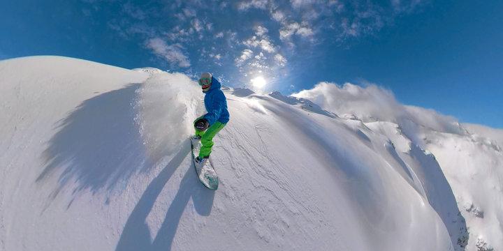 VR360: Athletic man on fun winter holidays snowboarding off piste in Slovenia.