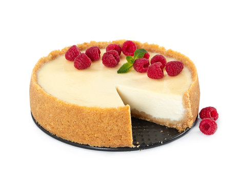Cheesecake with raspberries and mint isolated on white