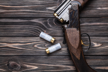 open hunting rifle on a wooden background