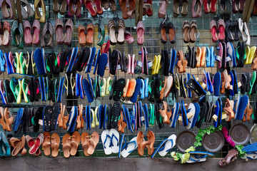 Sandles shoes flip flops hanging rows must colours in market India