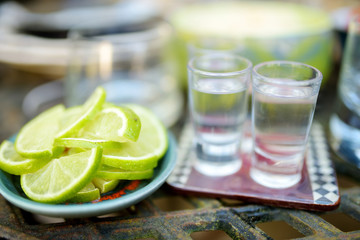 Mexican traditional drinks accompanied with lime and salt.