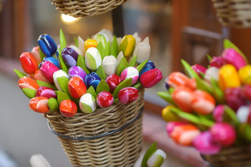 Wooden tulips and decorations sold on Easter market in Vilnius. Spring fair hold in March on the streets of capital of Lithuania