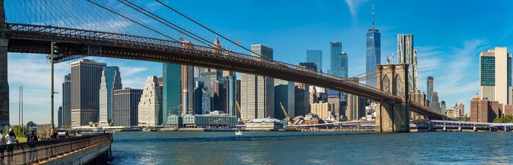 Iconic  view of Brooklyn bridge over Manhatten skyscrapers in New York.
