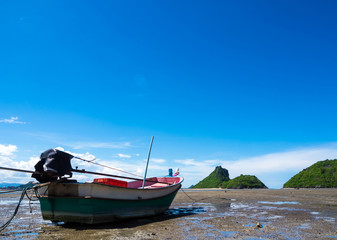Fishing boat in the bay, mountain and the clear blue sky