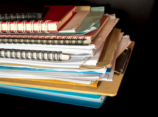 Stacked of office documents paper in the black background
