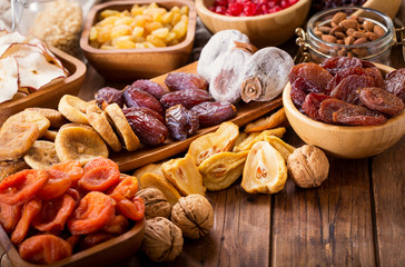 dried fruits on wooden table Wall mural
