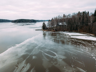 Aerial view of the winter frozen lake captured with a drone in Finland