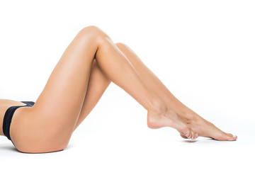 Beautiful woman legs on a white background. Body care. Healthcare