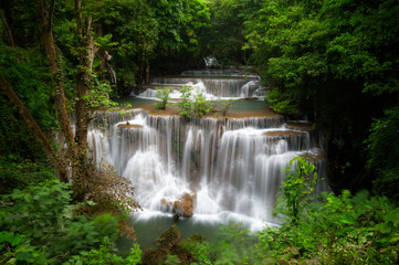 Huay mae khamin waterfall, this cascade is emerald green and popular in Kanchanaburi province, Thailand.