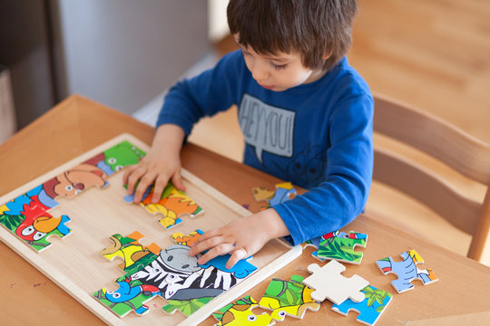 Child playing with puzzles