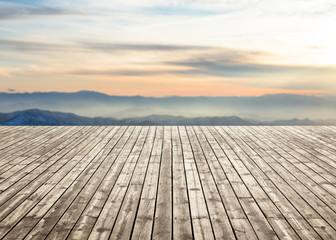 Wooden floor against Scenic view of mountain in winter. For your product placement or montage with focus to the table top in the foreground. Empty wood white shelf