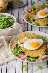 Potato pancakes with eggs and ham