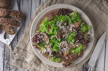Homemade bio salad lettuce with mushrooms and wholegrain bread