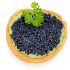 Canapes with black sturgeon caviar and  parsley. Isolated on the white background.
