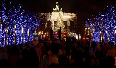 The Unter den Linden boulevard and the illuminated Christmas tree is pictured in front of the Brandenburg Gate in Berlin