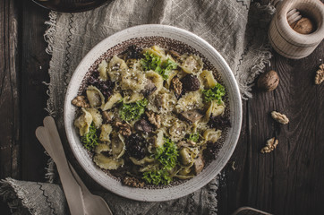 Homemade tortellini with mushrooms and walnuts