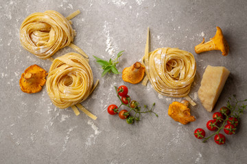 Raw pasta and ingredients above