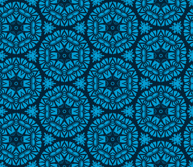 Seamless pattern from circular abstract floral ornaments in light blue color on a dark ocean blue background. Vector illustration. Suitable for fabric, wallpaper and wrapping paper