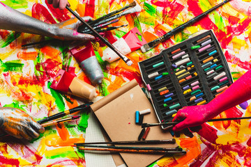 Art background, hands hold tassels. Artist toolsets. Easy to be painter with a lot of brushes tool. Wonderful instruments for creators. Dream art creative life. Creativity, contemporary art