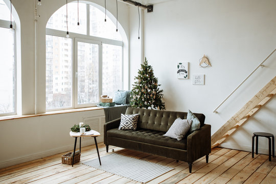 Bright living room with large Windows and Christmas tree decorated for Christmas