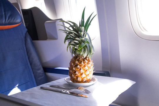 fresh yellow pineapple on the table in the plane