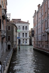 Canal street with walkway in Venice, Italy