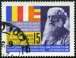 CEYLON - 1967: shows Colonel Henry Steel Olcott (1832-1907) and Buddhist flag