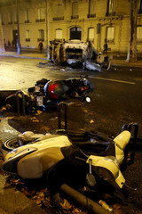 Damaged vehicles are seen on avenue Kleber after clashes with protesters wearing yellow vests, a symbol of a French drivers' protest against higher diesel taxes, in Paris