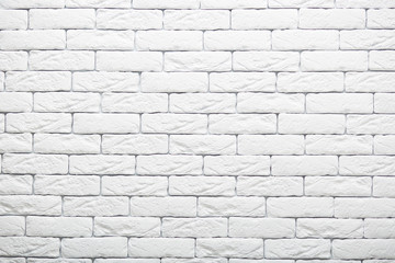 White brick wall texture for your background. Rural room. Abstract shot. Vintage structure. Whiten facade. Copy space for your advertsiement