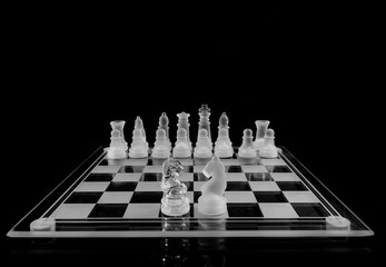 Glass chess board on a dark background