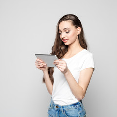 Portrait of beautiful teenager girl using digital tablet