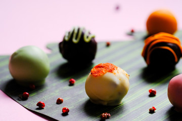 Beautiful background from color paper and tasty truffles.